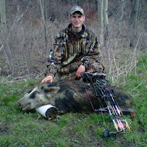 Boar hunter with kill