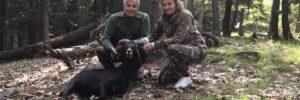 Hunting Couple Posing Next to Black Hawaiian Ram