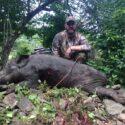 Archery Hunter Posing With Trophy Boar